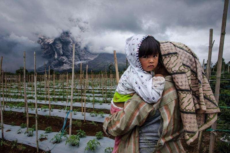 Ulet Ifansasti: Living Under Volcano